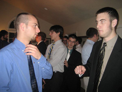 Brothers and prospective members at a formal rush function.